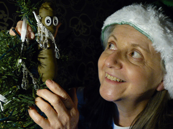 Selfie Elfie replaces the star on the christmas tree with a sausage